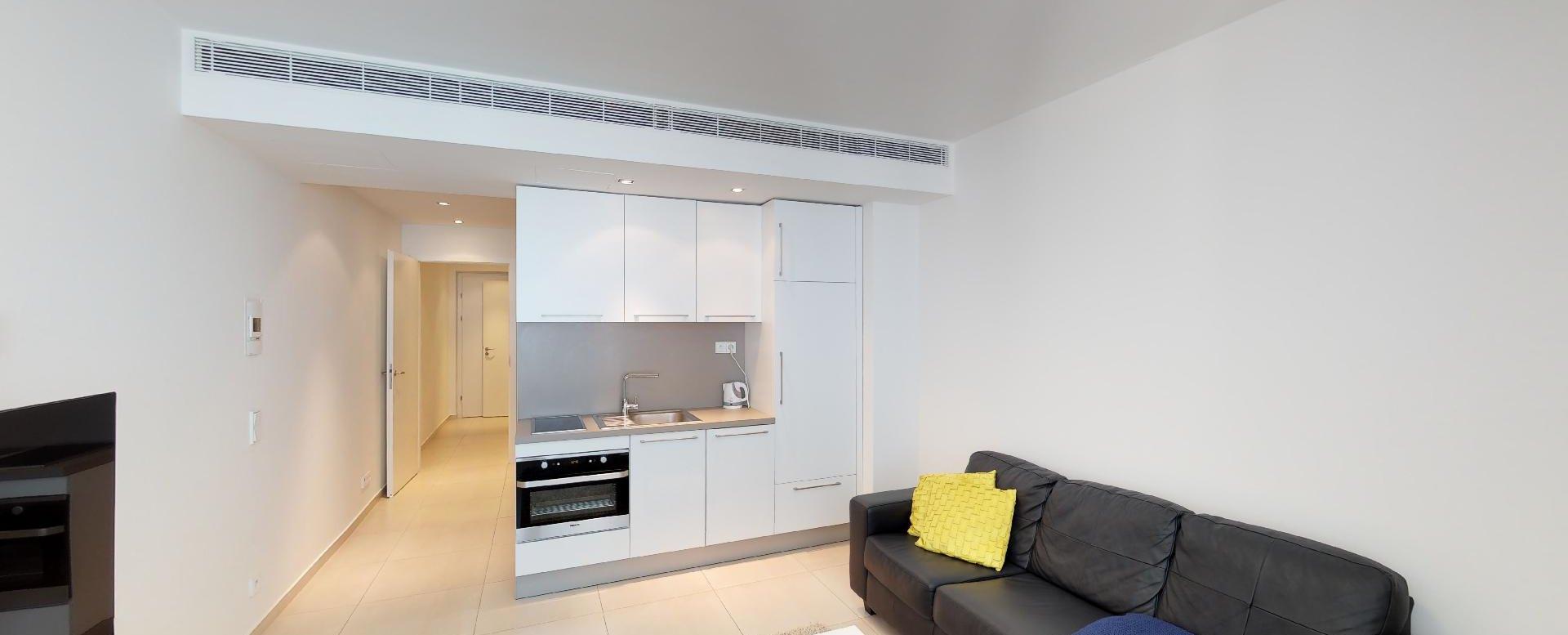 Obývacia izba s kuchynským kútom